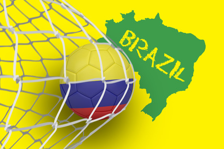 Football in colombia colours at back of net against green brazil outline on yellow with text photo