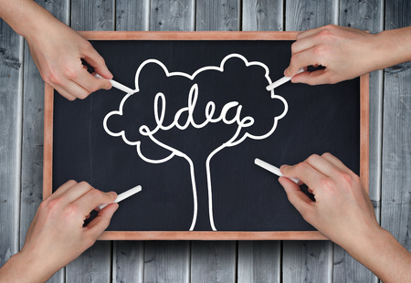 Composite image of multiple hands drawing idea tree with chalk on wooden board photo
