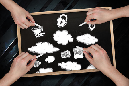 Composite image of multiple hands drawing clouds with chalk on blackboard photo