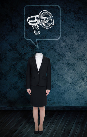Composite image of headless businesswoman with megaphone in speech bubble against dark grimy room photo