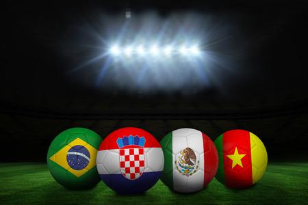 Group of footballs under spotlight on football pitch photo