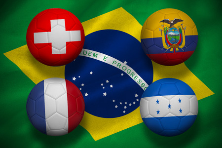 Footballs on brasil flag background photo