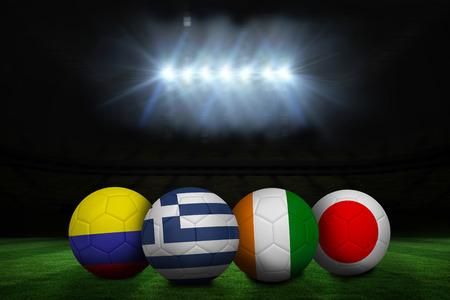 Group c footballs under spotlights on large pitch photo