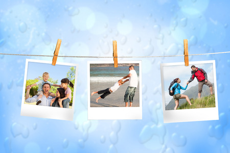 Composite image of instant photos hanging on a line against blue water drop background photo