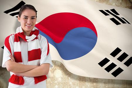 Football fan in white wearing scarf against korea republic flag photo