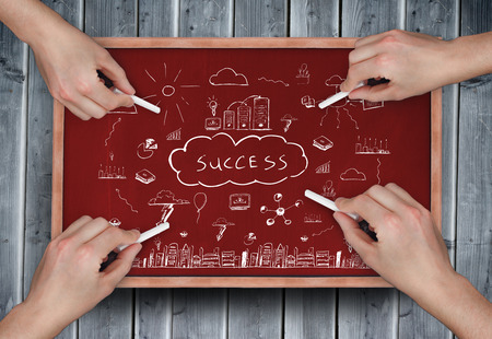 Composite image of multiple hands drawing success doodle with chalk on wooden board photo
