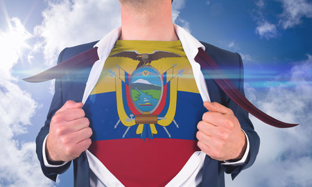 Businessman opening shirt to reveal ecuador flag against bright blue sky with clouds photo