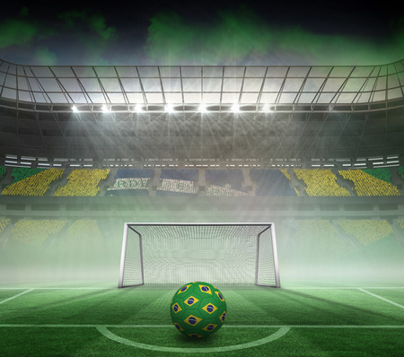 Football in brazilian colours against vast football stadium for world cup photo
