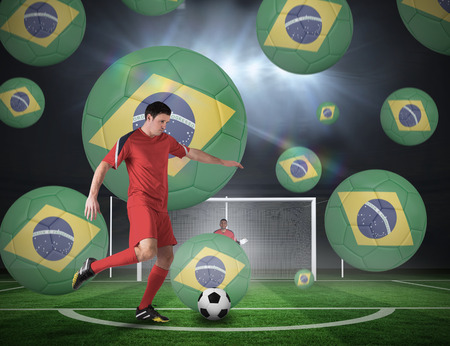 Composite image of football player about to take a penalty against football pitch under spotlights photo