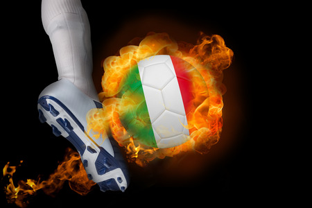 Football player kicking flaming italy ball against black photo