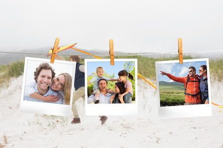 Composite image of instant photos hanging on a line against little boy on the beach photo