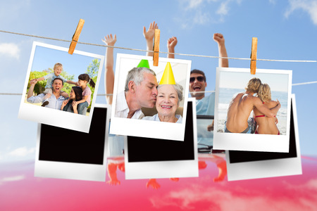Composite image of instant photos hanging on a line against cheering couple in convertible photo