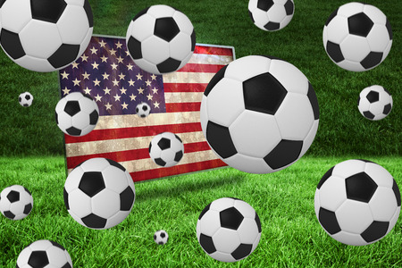 Black and white footballs against usa flag in grunge effect photo