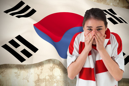 Nervous football fan looking ahead against korea republic flag photo