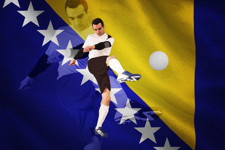 Football player in white kicking against digitally generated bosnian flag photo