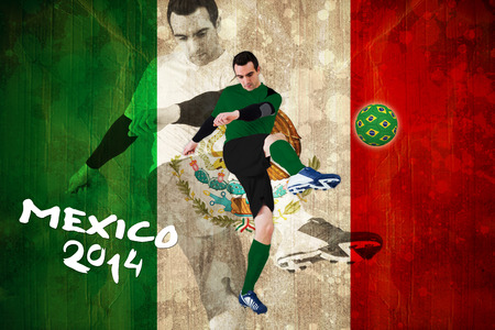 Football player in green kicking against mexico flag in grunge effect photo