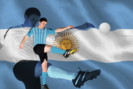 argentinian flag: Football player in blue kicking against argentinian flag