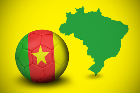 Football in cameroon colours against green brazil outline on yellow  photo