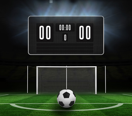 score under: Black scoreboard with no score and football against football pitch under spotlights