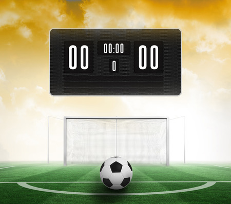 score under: Black scoreboard with no score and football against football pitch under yellow sky