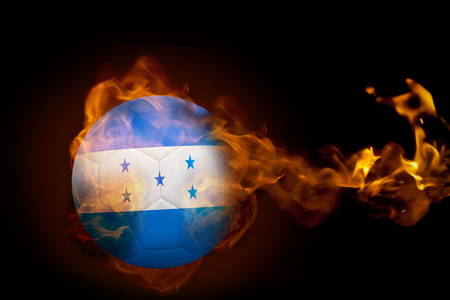 Composite image of fire surrounding honduras ball against black photo
