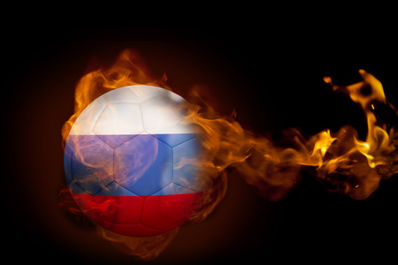 Composite image of fire surrounding russia ball against black photo