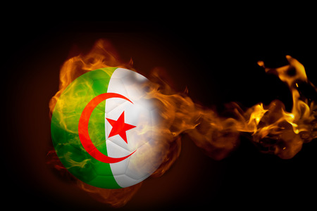 Composite image of fire surrounding algeria ball against black photo