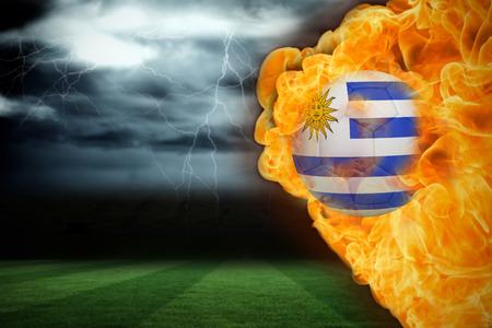 under fire: Imagen compuesta de incendio circundante flag football Uruguay contra campo de f�tbol bajo el cielo tormentoso
