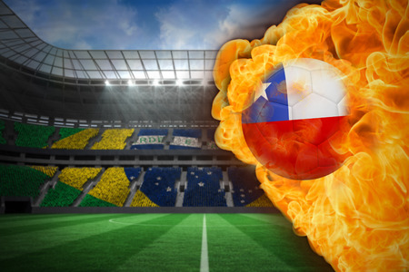 Composite image of fire surrounding chile flag football against large football stadium with brasilian fans photo