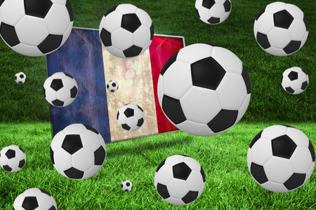 Black and white footballs against france flag in grunge effect photo