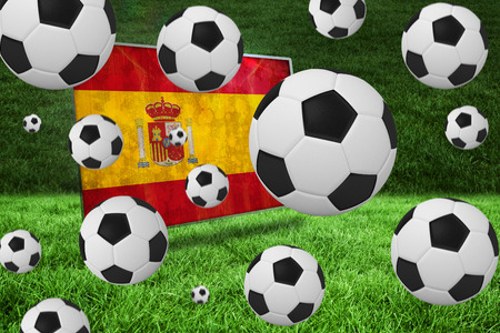 Black and white footballs against spain flag in grunge effect photo