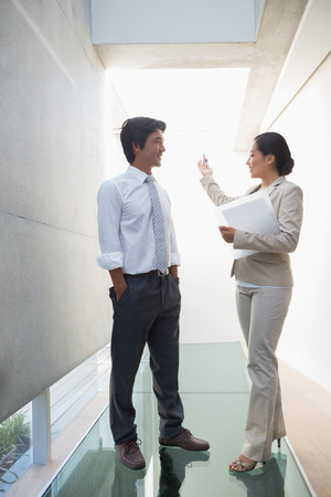 Estate agent speaking with potential buyer in the hallway photo
