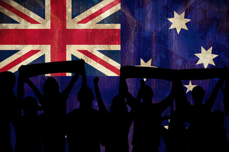Silhouettes of football supporters against australia flag in grunge effect photo