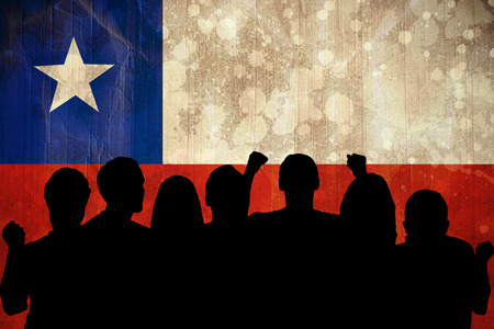Silhouettes of football supporters against chile flag in grunge effect photo