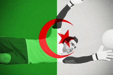 Goalkeeper in white making a save against algeria national flag photo
