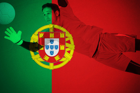 goal keeper: Fit goal keeper jumping up against portugal national flag