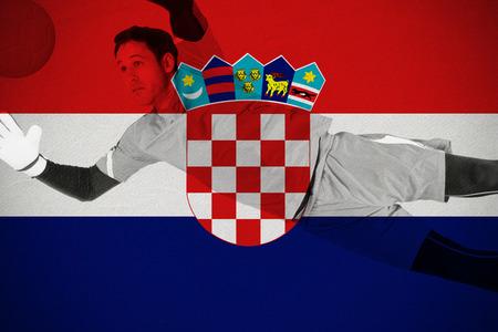 Fit goal keeper jumping up against croatia national flag photo
