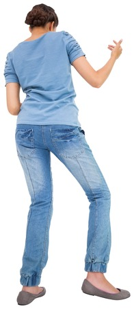 air guitar: Pretty brunette playing air guitar on white background Stock Photo