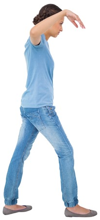 powerless: Powerless brunette in jeans and tshirt on white background Stock Photo