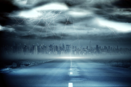 Digitally generated stormy sky with tornado over road photo