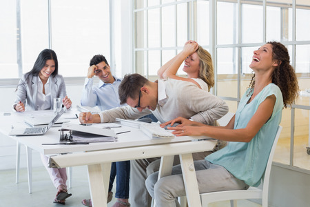 casual business: Casual business team laughing during meeting in the office