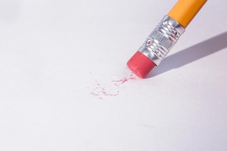 erasing: Pencil erasing on white page Stock Photo