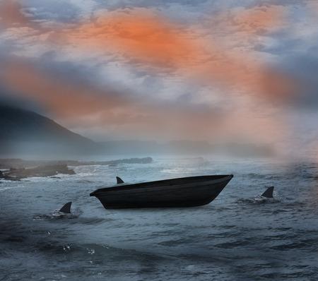circling: Sail boat being circled by sharks at night Stock Photo