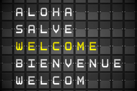 welcom: Welcome in languages on digitally generated black mechanical board Stock Photo
