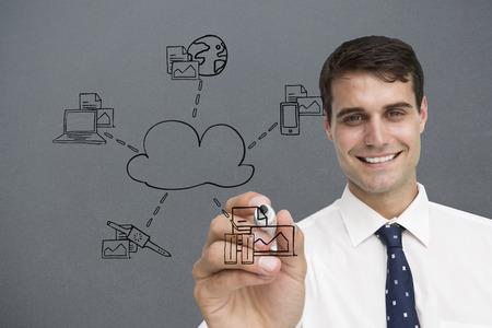 Businessman writing doodle against grey vignette photo