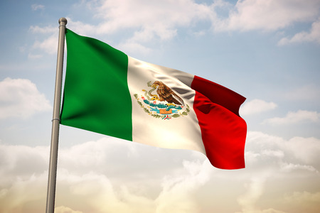 Mexico national flag against beautiful blue sky with clouds photo