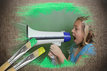 Composite image of little girl with bullhorn against weathered surface with paintbrushes photo