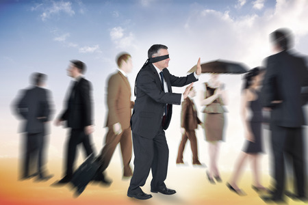 Mature businessman in a blindfold against beautiful orange and blue sky