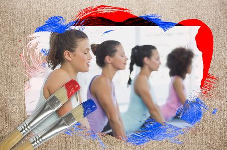 body paint: Imagen compuesta de clase de yoga en el gimnasio contra la superficie desgastada con pinceles