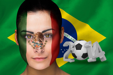Composite image of mexico football fan in face paint against world cup 2014 with brasil flag photo